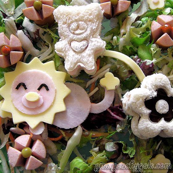 wurstlöwe und teddybär aus brot auf salat